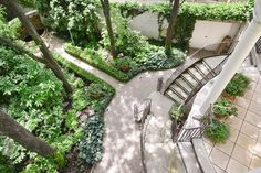 Re-designed home in Chicago features a circular terrace that leads to two staircases and a garden path.   http://www.estately.com/listings/info/2030-north-magnolia-avenue--4