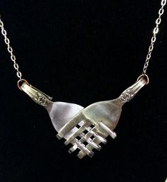 Awesome love holding hands necklace made out of forks and cheep!!