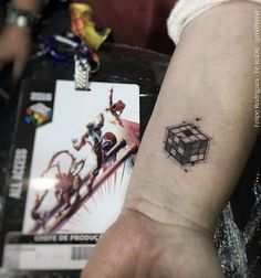 Rubik's cube wrist tattoo by Felipe Rodrigues Fe Rod