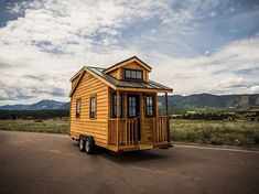 This is the 131 Sq. Ft. Linden 20 Horizon Tiny Home on Wheels by Tumbleweed Houses. From the outside, you'll notice that it offers a built-in, covered front porch along with a double dormer d…