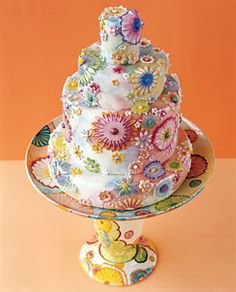 Groovy 70's wedding cake  http://www.brides.com/images/editorial/2004_brides/11_12_p055_customconfections/00_main/009_primary.jpg