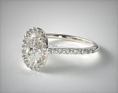 maybe add sidestones? - 14K White Gold Pave Halo Diamond Engagement Ring (Oval Center)