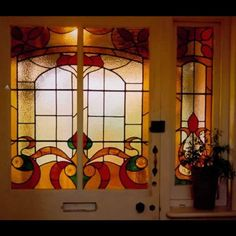 Traditionally styled stained glass door panels by Jude Alderman