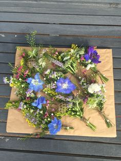 Wild flower buttonholes tied with string