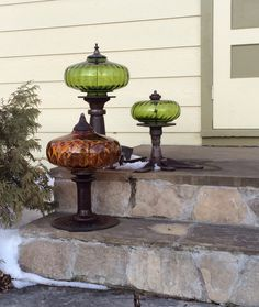 Repurposed garden art created using vintage lamps, discarded metal, and found objects.  |  SprUNg! by Donja