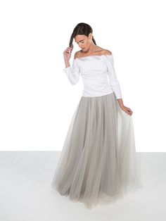 This stunning tulle grey wedding skirt is made from many layers of circular cut soft tulle with silk lining. All our tulle wedding skirts feature a concealed side zip, and are comprised of four layers of material (24 metres of material in total), each layer is made from different tones to create depth of colour. Multiple colours available, please see our colour options.  We can customise your skirt, make your order made-to-measure £75, or even create a custom colour £50.  Every order is made…