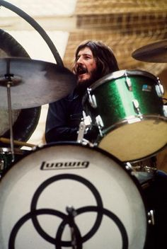 John Bonham of Led Zeppelin performs on stage at Oude Rai on May 1972 in Amsterdam, Netherlands. He plays a green sparkle Ludwig drum kit. (Photo by Gijsbert Hanekroot/Redferns) John Bonham, Jimmy Page, Robert Plant, Great Bands, Cool Bands, Led Zeppelin Drummer, Hard Rock, Heavy Metal, Rock Y Metal