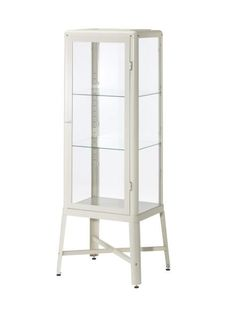 """A pair of adjustable shelves allows for customizable storage. Fabrikör 22 1/2""""W x 18 1/2""""D x 59""""H metal and glass cabinet in beige, $179, ikea.com"""