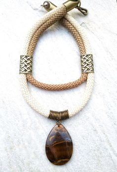 Thin gold chain with five mini triangles sparkling with inlaid crystals. Minimal and geometric, this necklace will become a daily fixture in your jewelry routine. Dimensions: Adjustable 15 in chain necklace. Triangle pendants measure in width an Triangle Necklace, Rope Necklace, Beaded Necklace, Fabric Jewelry, Beaded Jewelry, Jewelry Necklaces, Jewelry Findings, Wire Jewelry Designs, Jewelry Accessories