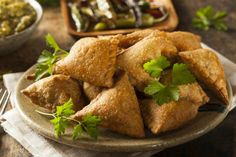 These beef samosas are fantastic for your parties as an appetizer or you can prepare them as a snack for you and your family. Try this recipe for beef samosa, with their outstanding taste, and amaze everybody with your cooking skills! Beef Samosa Recipe, Chaat Recipe, Curry Recipes, Indian Samosas, Samosa Chaat, Indian Snacks, Indian Food Recipes, Recipes, One Pot Dinners
