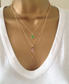 A stunning 3 layer Gold Filled Necklace Set. (These are 3 separate individual Necklaces)  The little Green Evil Eye Charm is encased in Gold plated Metal and hangs nicely from a 16 (41cm) dainty 14k Gold Filled Chain.  The really cute Mini Gold Filled Hamsa Charm hangs nicely from a strong but delicate 18 14k Gold Filled Chain  The little Boho hammered Teardrop Pendant hangs from a lovely 20 (51cm) Rollo/Mini Belcher 14k Gold Filled Chain.  All the Chains and the Hamsa and Teardrop cha...