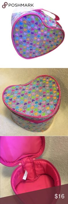 """Glittery Heart Case Soft sided bright heart shaped glossy carry all / case with one open compartment. Lined in bright pink. Silver glitter all around with pink purple blue green and orange hearts. Full zip closure. Measures 8"""" by 6"""" and is 4"""" deep Bags"""