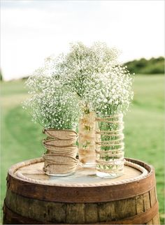 Find cylindrical glass vases and twine for these rustically romantic wedding centerpieces on our website: http://www.lightsforalloccasions.com/c-411-vases-vase-filler.aspx