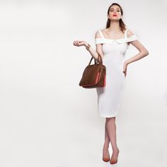 Take your work day by storm in a knee-length dress, well-swept hair, cuff bracelets, angular statement jewelry, a pair of designer pump shoes, and a structured #workbag on the wrist. Get ready to carry off your work look with élan with this #satchel available at any Exclusive Baggit stores or www.baggit.com.  Shop Now : https://goo.gl/kC6FuP