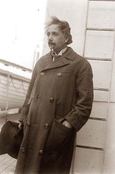 You are viewing an unusual image of Albert Einstein. The image shows Einstein on a ship, smoking a pipe and holding his hat.
