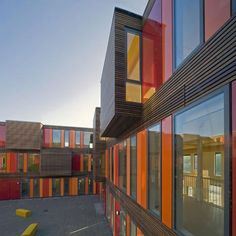 Bright and Blocky Modular Portable School in Amsterdam.. This is a placeholder for a permanent school to come in the next 5-10years, but it can very easily be moved to a new location to make way for construction. Dutch firm HVDN designed it with a wooden facade and colorful aluminum panels. Really neat, well-designed, and modern, as well as very flexible!