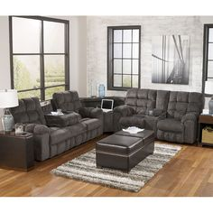 Filling your home's recreational area just got easier. The Acieona Slate Reclining Sectional by Signature Design by Ashley Furniture features unique combination of motion features combined with stationary functions, makes it the perfect addition to your home. The sectional sofa s flow starts and ends with end reclining seats, drop down theater cup-holders, and hidden storage with exposed cup-holders