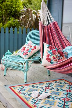 Striped hammock with floral and gingham cushions, patterned rug and green wicker seat, all by Carolyn Donnelly eclectic Outdoor Spaces, Outdoor Living, Bedroom Inspo, Bedroom Ideas, Eclectic Design, Hanging Chair, Room Inspiration, Wicker, Cushions