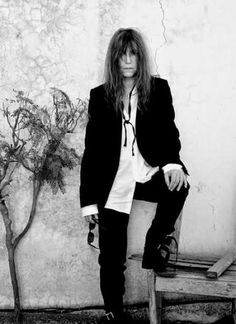 It's Patti Smith on holiday. Actually, she might not be on vacation it could be Maine, but I do like the idea of Ann Demeulemeester reso...