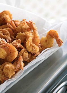 Bayou Fried Shrimp - 100 Ways to Cook Southern - Southernliving. Recipe: Bayou Fried Shrimp For these Cajun-flavored fried shrimp, peel the shrimp but leave the tails on and coat the shrimp in fish fry mix to get a crispy brown coating. Fried Shrimp Recipes, Shrimp Dishes, Cajun Recipes, Seafood Recipes, Cooking Recipes, Supper Recipes, Cajun Food, Cajun Cooking, Shrimp Meals