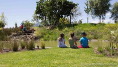 Children enjoy some nature time at Nooitgedaght eco village park designed by Style Council Exterior Designers. Wetland ponds, river sreams, natural landscaping, food forests and entertainment space for young and old. Contact www.stylecouncil.co.za Gold Award  Property Development