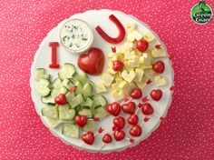 Veggify Valentine's Day! Hearts: cherry tomatoes, zucchini, yellow squash Letters: red bell peppers