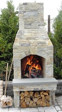 Picture relaxing by your own cozy outdoor fireplace.