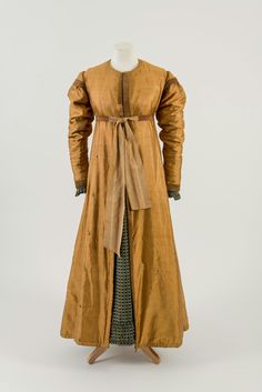 Fashion Museum Bath ( - Regency era warmth with this cinnamon gold silk pelisse, circa Lined with padded silk, with velvet detailing and a beautiful ribbon waist tie. Regency Dress, Regency Era, Tulle Ball Gown, Ball Gowns, Princess Line Dress, Josephine, Gold Silk, Outerwear Women, New Fashion