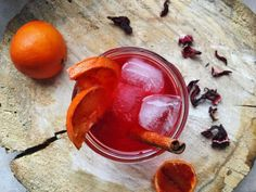 A zesty blend of citrus and spice make this caffeine-free Jamaican Hibiscus Iced Tea incredibly delicious and refreshing! By Lauren Sacerdote