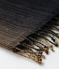NOTE: Gorgeous woven dark fabrics would create nice contrast with the light neutral sofas and light colored carpet.