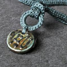 New Aliquid Ceramic Raku Pendant Necklaces. Cotton knitted and ceramic pendants.