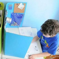 If you need space for multiple kids to study, or if you're looking for a mobile option, turn 3-paneled display boards into personal workstations with built in organizers.
