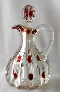Ruby stained broken column cruet. The cruet was made by Columbia Glass Co. circa 1888.