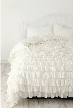 white ruffled bed