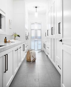"At six metres long, this laundry offers an abundance of storage space. ""We included drying cupboards and lots of spots for the owner to… House, Laundry Mud Room, Bathroom Interior Design, Interior, Home, Storage Spaces, Laundry Design, Laundry Room Wall Decor, Australian Homes"