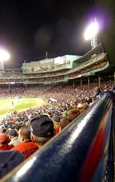 Go to boston to see major league baseball game, to watch the redsoxs play in  fenwaypark.