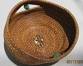 Dee Reichert Coiled pine needle basket with dropped side and turquoise beads