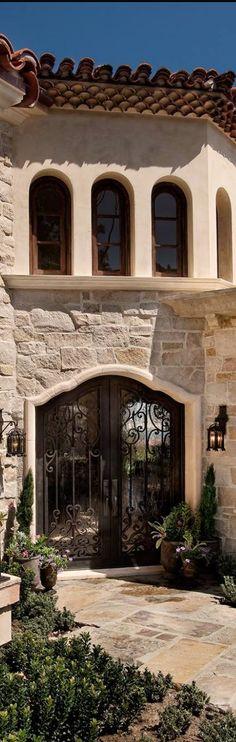tuscan iron door stone clay tile