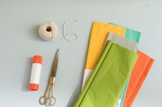 DIY: Bunting. neat idea using the cardboard from a paper towel roll to store the bunting.