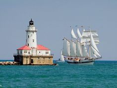 Tall Ship Windy Sails Past the Chicago Harbour Lighthouse, IL. Also comes to the harbor in Lorain, OH. Beautiful ship and friendly crew. My grandson Tyler gave them a quilt his great grandmother made...