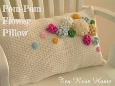 Pom-Pom Flower Pillow tutorial. Pillow is made from a sweater.