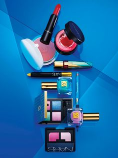 BRIGHTEN UP THIS SEASON WITH JEWEL-TONE SHADOWS, STRIKING GOLD LINER, AND EYE-POPPING POLISH FOR A LIVELY LOOK