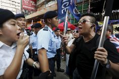 A protester argues with a police officer during a demonstration in Hong Kong, China July 1, 2015, the day marking the 18th anniversary of Hong Kong's handover from Britain to Chinese sovereignty. Thousands of Hong Kong protesters marched for full democracy on Wednesday and called on the Chinese-controlled city's leader to resign, just weeks after lawmakers voted down an electoral reform package backed by Communist Party leaders in Beijing. REUTERS/Bobby Yip