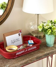 Without the wheels, a little red wagon makes the perfect unexpected credenza catchall.