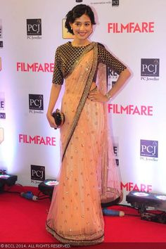 Amrita Rao looks resplendent in a saree as she walks the red carpet at the 59th Idea Filmfare Awards 201324, 2014.