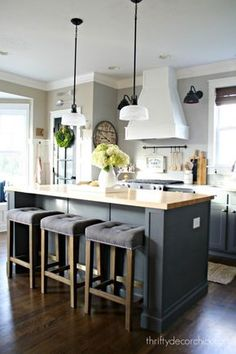 love the white range hood, the grey cabinets and grey/taupe wall colour