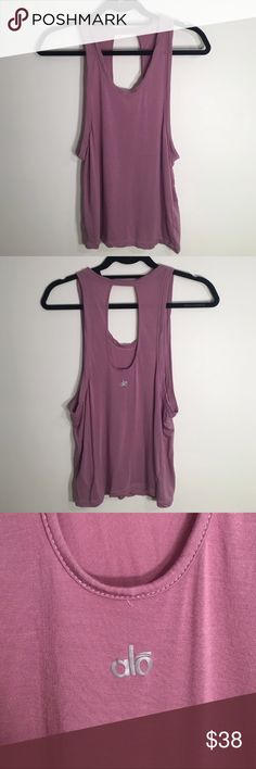 ALO Yoga Muscle Tank ALO Yoga muscle tank with large keyhole cutout in back. Gorgeous pink/purple mauve color in super soft, light weight material.   Gently loved in excellent condition, with no signs of wear. Comes from a smoke free home. ALO Yoga Tops Tank Tops