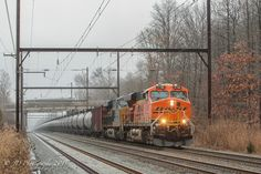 https://flic.kr/p/Cw73we   BNSF GE ES44AC #5788 @ Oxford Valley, PA   Loaded CSX oil train K138 approaches CP TL on the Trenton Sub on a cold and misty December afternoon. The train was held for a short time at CP Summit in West Trenton, NJ while the rail train cleared up into Woodbourne Yard.