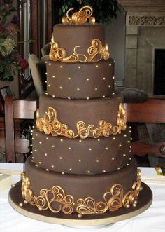 Beautiful chocolate colored wedding cake with caramel colored swirls