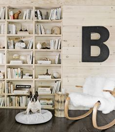 In this Massachusetts cabin, an Ikea sheepskin softens a 1970s bentwood rocker, which belonged to the owner's father. The tin B was part of a gas station sign.   - CountryLiving.com
